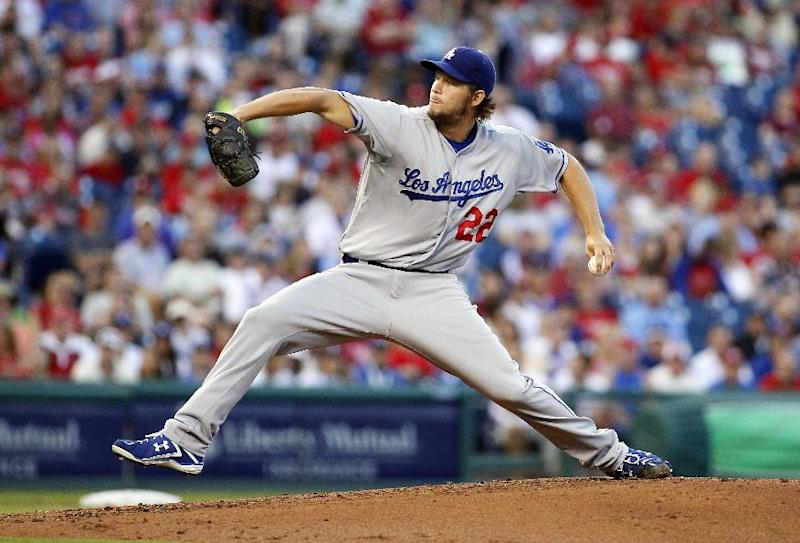 Los Angeles Dodgers' Clayton Kershaw winds up during the first inning of a baseball game against the Philadelphia Phillies, Saturday, Aug. 17, 2013, in Philadelphia. (AP Photo/Tom Mihalek)