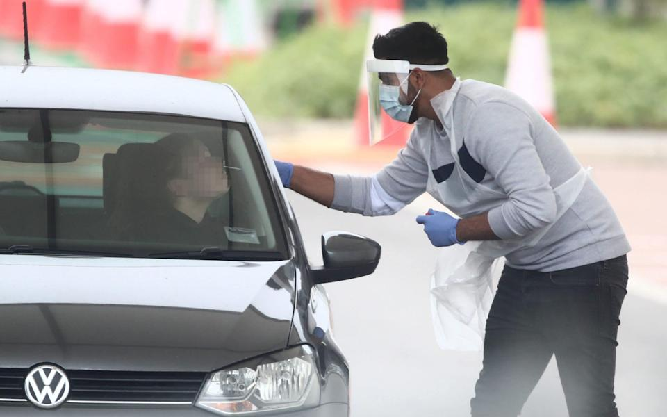 A motorist is tested for Covid-19 in Leeds - Danny Lawson/PA