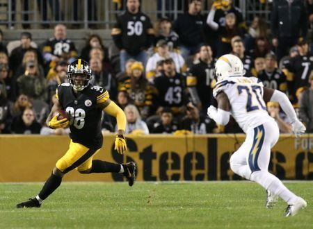 FILE PHOTO: Dec 2, 2018; Pittsburgh, PA, USA; Pittsburgh Steelers running back James Conner (30) rushes the ball as Los Angeles Chargers defensive back Desmond King (20) chases during the second quarter at Heinz Field. Mandatory Credit: Charles LeClaire-USA TODAY Sports