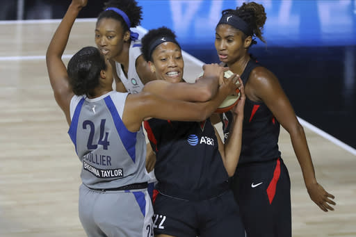 Las Vegas Aces' A'ja Wilson (22) fights for the ball with Minnesota Lynx's Napheesa Collier (24) during the first half of a WNBA basketball game Thursday, Aug. 13, 2020, in Bradenton, Fla. (AP Photo/Mike Carlson)