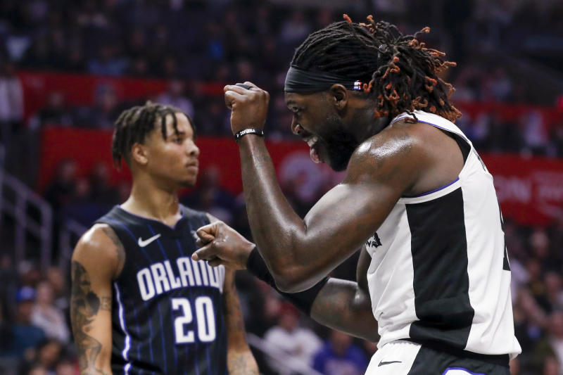 Los Angeles Clippers forward Montrezl Harrell celebrates after scoring as Orlando Magic guard Markelle Fultz looks away during the second half of an NBA basketball game in Los Angeles, Thursday, Jan. 16, 2020. The Clippers won 122-95. (AP Photo/Chris Carlson)