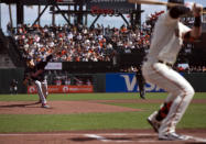 Atlanta Braves starting pitcher Max Fried, left, delivers to San Francisco Giants' Kris Bryant, right, during the first inning of a baseball game, Sunday, Sept. 19, 2021, in San Francisco. (AP Photo/D. Ross Cameron)