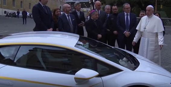 Pope Francis with his new special-edition Lamborghini Huracan.