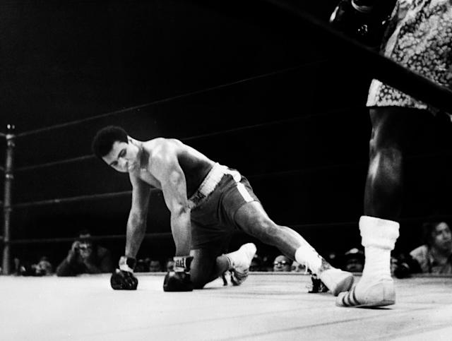 <p>A picture taken March 08 1971 in New York at the Madison Square Garden of the heavyweight boxing world championship fight between Muhammad Ali (Cassius Clay) (on the floor) and Joe Fazier at the end of which Frazier kept his title of heavyweight boxing world champion. (AFP/Getty Images) </p>