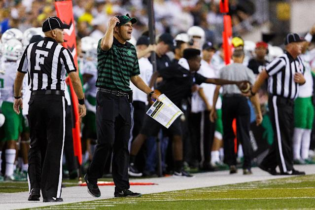 Oregon coach Mark Helfrich yells during the first quarter of an NCAA college football game against South Dakota in Eugene, Ore., Saturday, Aug. 30, 2014. (AP Photo/Ryan Kang)