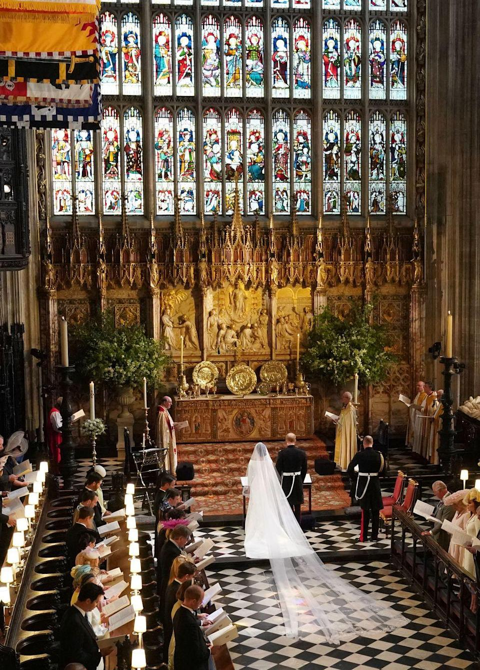 <p>The stained-glass windows, the alignment of the seats, Meghan's majestic veil...everything is perfect. </p>