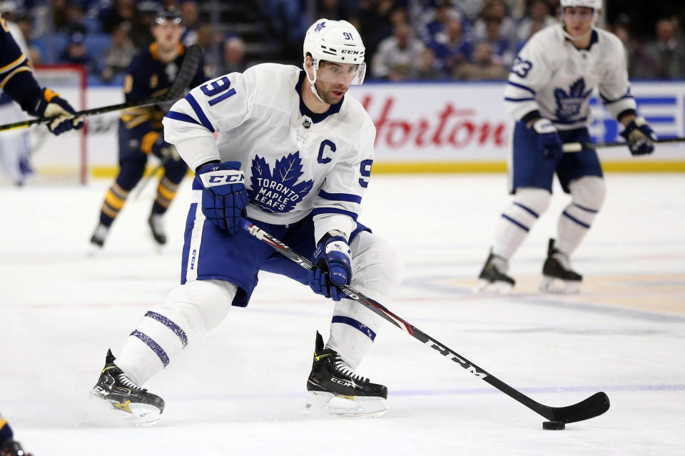 FILE - In this Feb. 16, 2020, file photo, Toronto Maple Leafs forward John Tavares (91) carries the puck during the first period of an NHL hockey game against the Buffalo Sabres in Buffalo, N.Y. Among the unknowns about the NHL returning amid the coronavirus pandemic is what the on-ice product might look like. (AP Photo/Jeffrey T. Barnes, File)