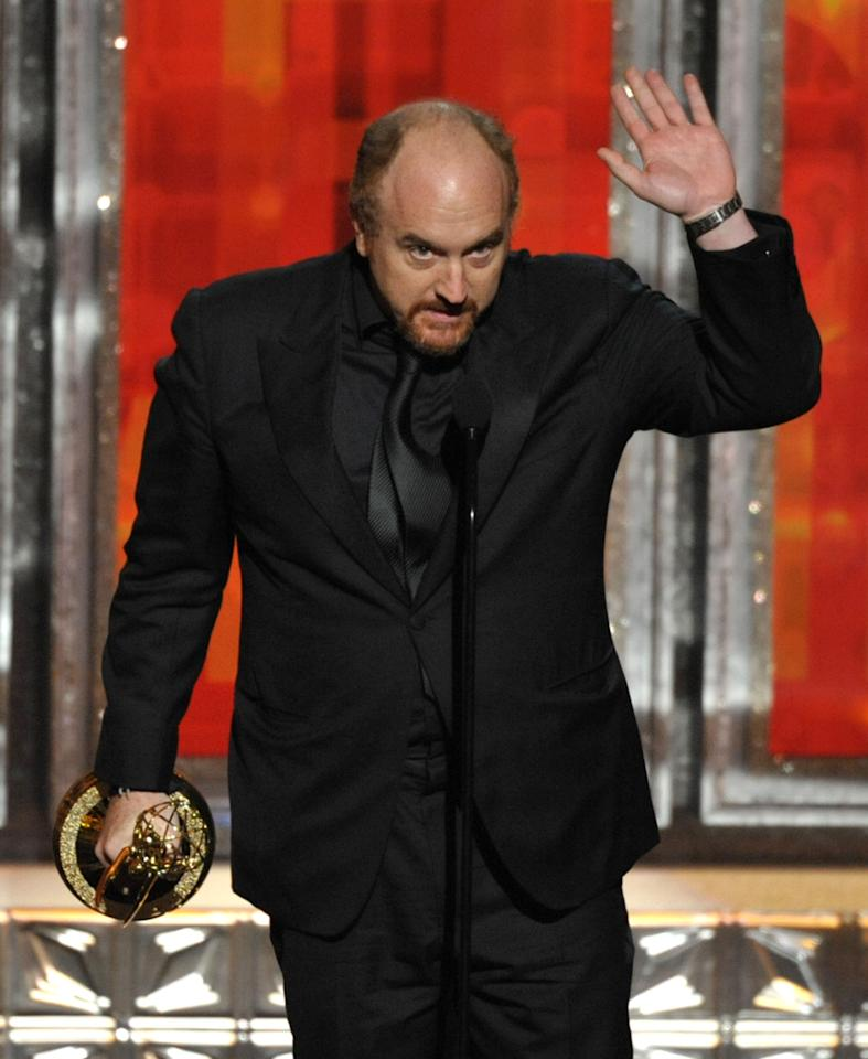 "Louis C.K. accepts the award for outstanding writing in a comedy series to for ""Louie"" at the 64th Primetime Emmy Awards at the Nokia Theatre on Sunday, Sept. 23, 2012, in Los Angeles. (Photo by John Shearer/Invision/AP)"
