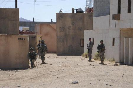Afghan Uniform Police and soldiers from the U.S. Army 4th Brigade Combat Team train at National Training Center at Ft. Irwin California