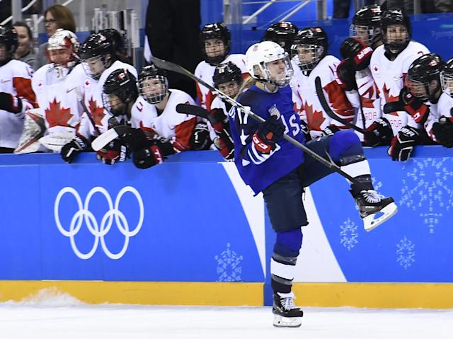 <p>Team USA celebrates winning after a penalty shootout in the women's gold medal ice hockey match between Canada and the US during the Pyeongchang 2018 Winter Olympic Games at the Gangneung Hockey Centre in Gangneung on February 22, 2018. / AFP PHOTO / Ed JONES </p>