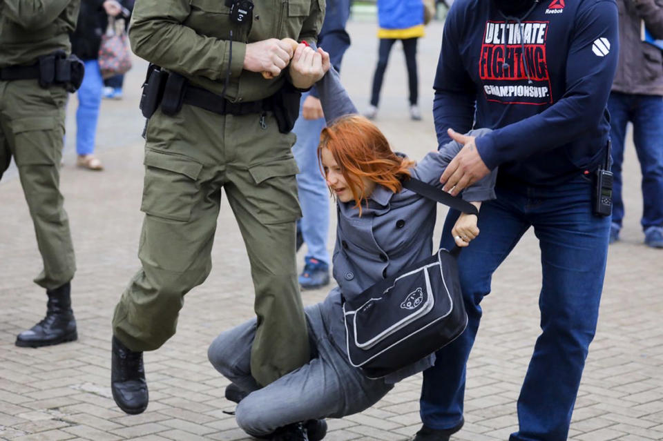 Police officers detain a woman during a rally in support of Maria Kolesnikova, a member of the Coordination Council created by the opposition to facilitate talks with Lukashenko on a transition of power, was detained Monday in the capital of Minsk with two other council members, in Minsk, Belarus, Tuesday, Sept. 8, 2020. A leading opposition activist in Belarus is being held on the border with Ukraine after she resisted attempts by authorities to deport her from the country as part of a clampdown on protests against authoritarian President Alexander Lukashenko. (AP Photo)