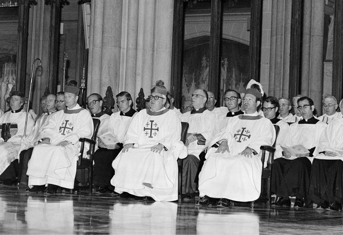 FILE - In this June 29, 1977 file photo, three newly-ordained Roman Catholic Bishops are seated among others participating in their ordination ceremonies in New York's St. Patrick's Cathedral. The bishops are, from left, Theodore E. McCarrick, Austin B. Vaughn, and Francisco Garmendia. All three bishops are Spanish speakers and were chosen in consideration of the growing Hispanic population of New York City and the suburbs. (AP Photo/Marty Lederhandler, File)