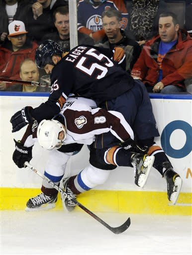 Edmonton Oilers' Ben Eager (55) collides with Colorado Avalanche Jan Hejda during the first period of an NHL hockey game, Tuesday, Jan. 31, 2012, in Edmonton, Alberta. (AP Photo/The Canadian Press, John Ulan)