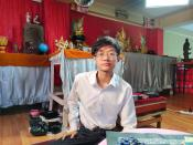 Hein Min Aung, an astrologer, sits in his home, where he receives guests to tell their fortunes, in Yangon