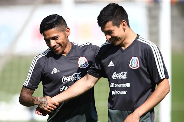 Football Soccer - Mexico's national soccer team training - World Cup 2018 - Mexico City, Mexico - May 17, 2018 - Mexico's player Javier Aquino (L) and Hirving Lozano attend a training session. REUTERS/Edgard Garrido