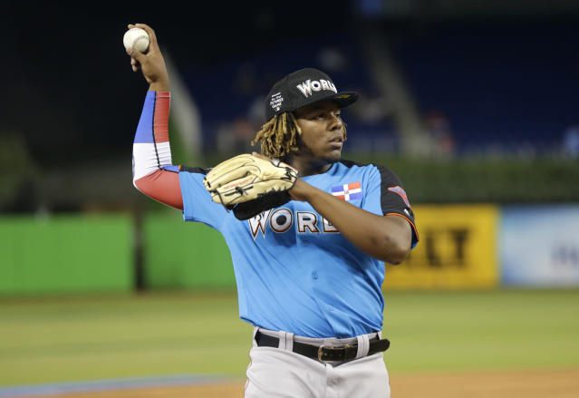 World Team designated hitter Vladimir Guerrero Jr., of the Toronto Blue Jays, warms up before the All-Star Futures baseball game, Sunday, July 9, 2017, in Miami. (AP)
