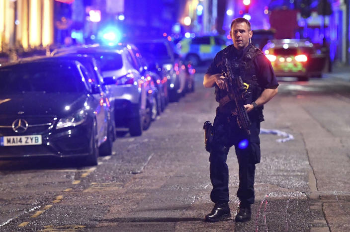 <p>An armed police stands on Borough High Street as police are dealing with an incident on London Bridge in London, Saturday, June 3, 2017. Witnesses reported a vehicle hitting pedestrians and injured people on the ground. (Dominic Lipinski/PA via AP) </p>