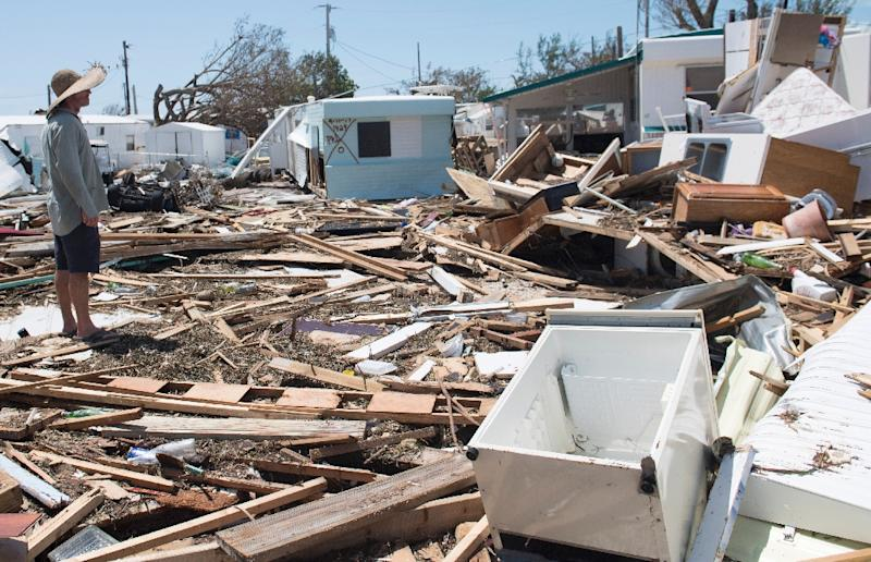 Bill Quinn surveys the damage to his trailer home from Hurricane Irma at the Seabreeze Trailer Park in Islamorada in the Florida Keys (AFP Photo/SAUL LOEB)