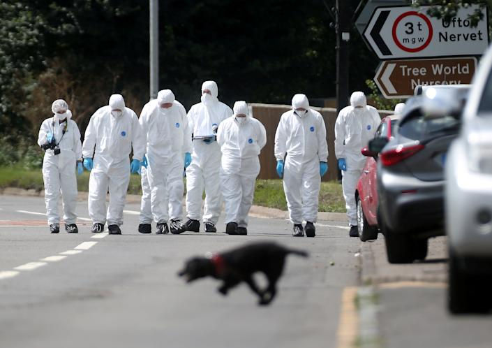 Combing the area: Forensics officers scour the scene where Pc Harper lost his life. (SWNS)