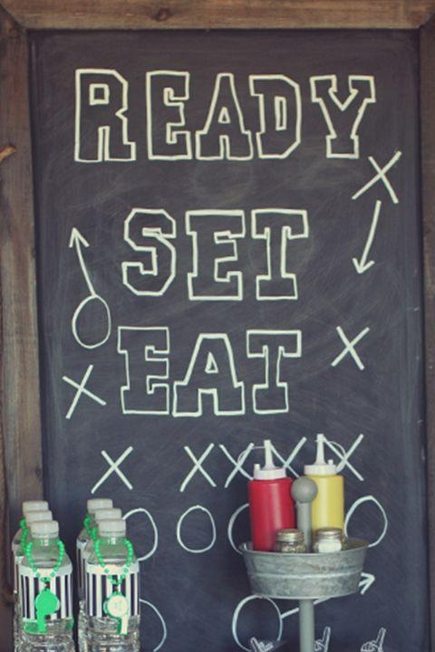 "<p>If you've got a chalkboard or chalkboard wall in your house, you can put it to use as a party decoration everyone will love.<br></p><p><em><a href=""http://www.threelittlemonkeysstudio.com/10-free-football-printables-get-together/"" rel=""nofollow noopener"" target=""_blank"" data-ylk=""slk:Get the tutorial at Three Little Monkeys Studio »"" class=""link rapid-noclick-resp"">Get the tutorial at Three Little Monkeys Studio »</a></em> </p>"