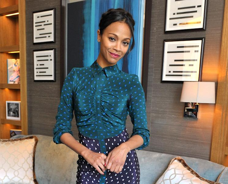 "FILE - In this Saturday, May 4, 2013 file photo, Zoe Saldana poses for a portrait session at the Corinthia Hotel in London. The 34-year-old star of ""Avatar"" and ""Star Trek"" plays pianist, singer and activist Nina Simone in the forthcoming biopic ""Nina."" (Photo by Richard Chambury/Invision/AP, File)"