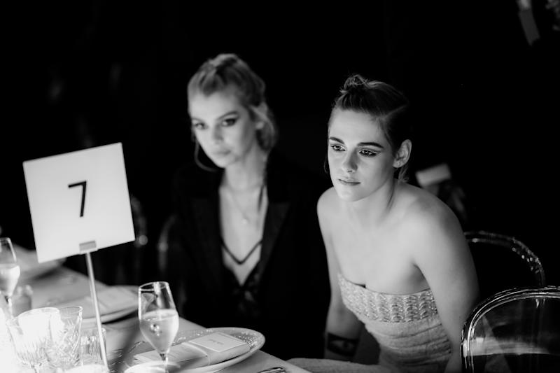 CANNES, FRANCE - MAY 13: (EDITORS NOTE: Image has been converted to black and white) Stella Maxwell and Kristen Stewart attend the Women in Motion Awards Dinner, presented by Kering and the 71th Cannes Film Festival, at Place de la Castre on May 13, 2018 in Cannes, France. (Photo by Vittorio Zunino Celotto/Getty Images for Kering)