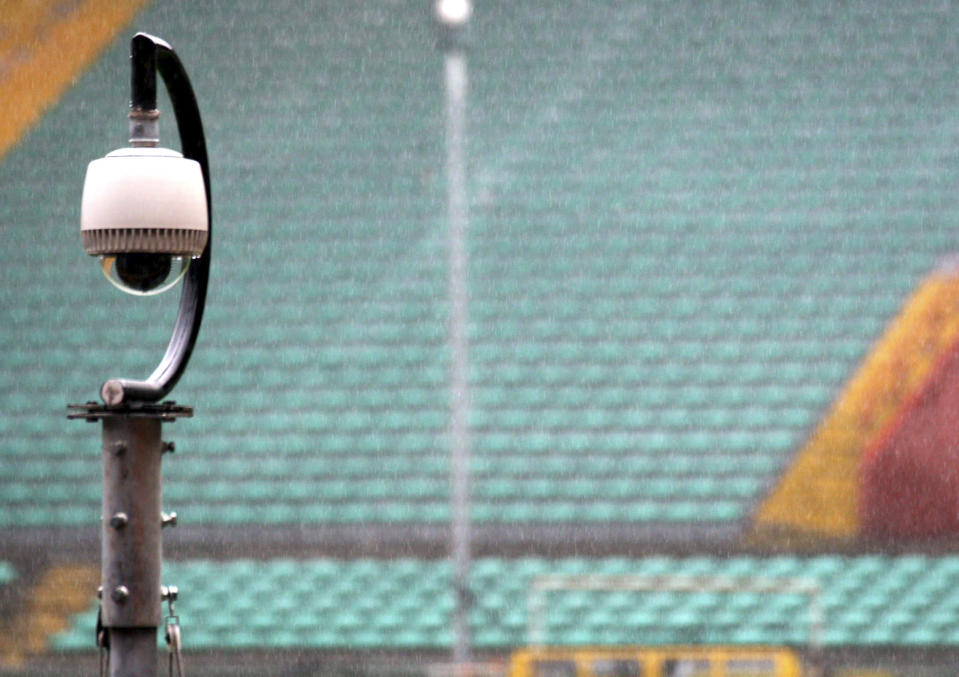 """FILE - In this Feb. 6, 2007, file photo, a camera overlooking the stands is seen at Luigi Ferraris stadium in Genoa, Italy, during the unveiling to the press of the new security control room. Dave Karls has Bucks season tickets and is eager enough for his next visit to Fiserv Forum that having his location trackable in the arena would not interfere with the enjoyment. """"I'd much rather have that than not be able to attend the game at all,"""" Karls said. Such concern depends on an individual's definition of surveillance, a word that carries nefarious connotation in some corners. (AP Photo/Italo Banchero, File)"""