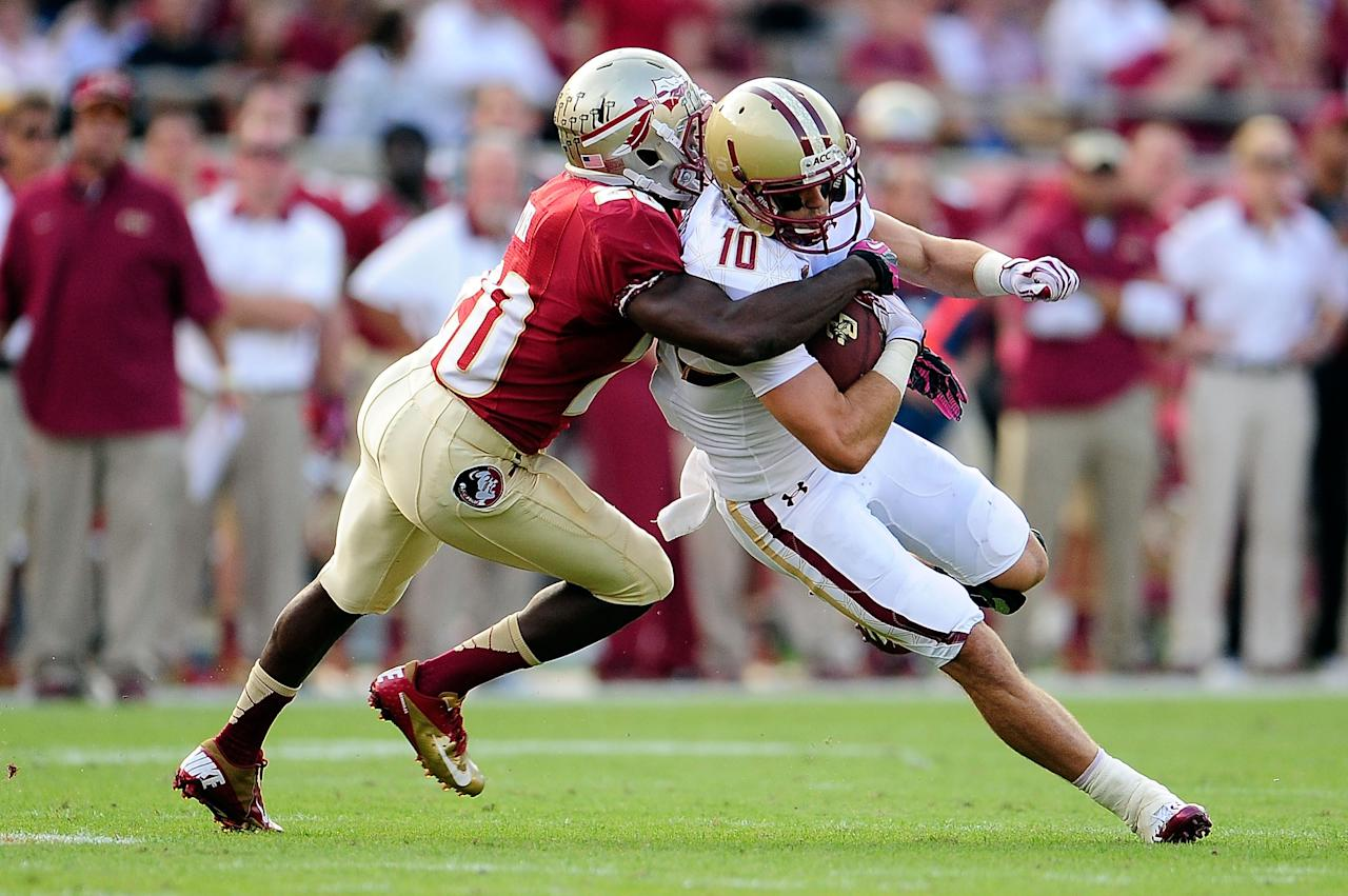 TALLAHASSEE, FL - OCTOBER 13:  Bobby Swigert #10 of the Boston College Eagles is brought down by Lamarcus Joyner #20 of the Florida State Seminoles during a game at Doak Campbell Stadium on October 13, 2012 in Tallahassee, Florida.  (Photo by Stacy Revere/Getty Images)
