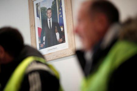 The official portrait of French President Emmanuel Macron is seen during a meeting with yellow vests movement members at the city hall in Flagy, France, January 9, 2019. REUTERS/Benoit Tessier