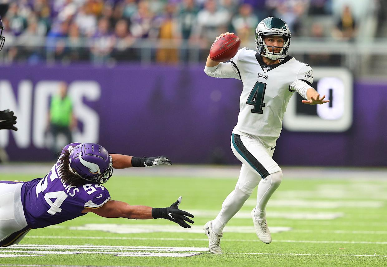 MINNEAPOLIS, MN - OCTOBER 13: Jake Elliott #4 of the Philadelphia Eagles throws an interception while Eric Kendricks #54 of the Minnesota Vikings attempts the tackle in the second quarter at U.S. Bank Stadium on October 13, 2019 in Minneapolis, Minnesota. (Photo by Adam Bettcher/Getty Images)