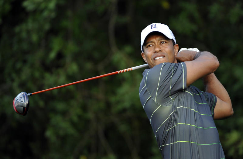 Tiger Woods tees off on the third hole during the pro-am at the Honda Classic golf tournament in Palm Beach Gardens, Fla., Wednesday, Feb. 29, 2012. (AP Photo/Rainier Ehrhardt)