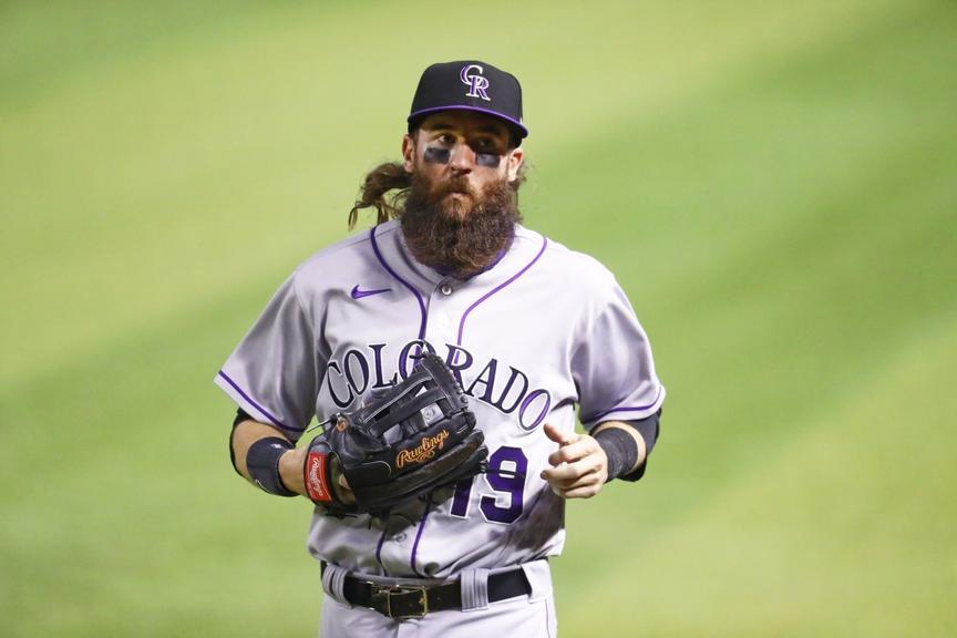 Rockies OF Charlie Blackmon jogging in from the outfield
