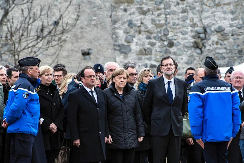 French President Francois Hollande (3rd left), German Chancellor Angela Merkel (centre) and Spanish Prime Minister Mariano Rajoy (2nd right) arrive at Seyne-les-Alpes on March 25, 2015, near the site where a German airliner crashed in the French Alps (AFP Photo/Jeff Pachoud)