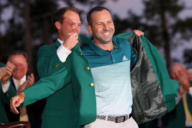 Danny Willett of England presents Sergio Garcia of Spain with the green jacket after Garcia won in a playoff during the final round of the 2017 Masters tournament, at Augusta National Golf Club in Georgia, on April 9 (AFP Photo/Andrew Redington)