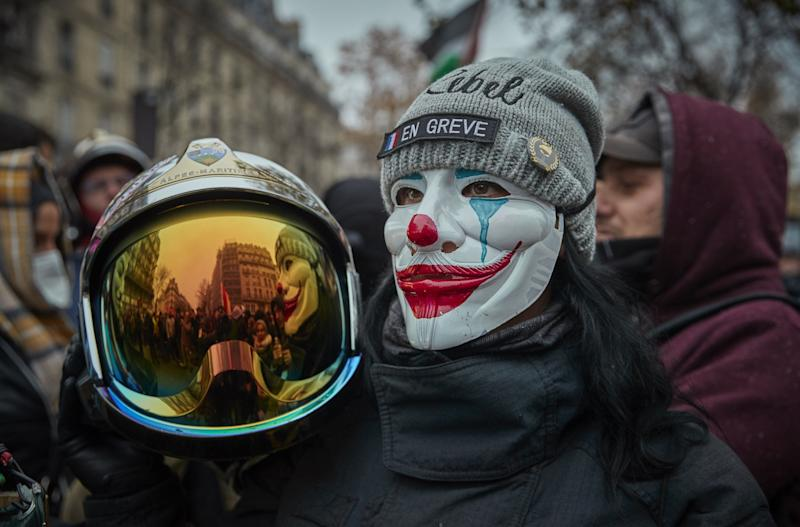 A french fire officer joins the protests against President Macron during a rally near Place de Republique (Getty Images)