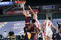 Iona's Dylan van Eyck, left, goes up for a shot past Fairfield's Jesus Cruz in the second half of an NCAA college basketball game during the finals of the Metro Atlantic Athletic Conference tournament, Saturday, March 13, 2021, in Atlantic City, N.J. (AP Photo/Matt Slocum)