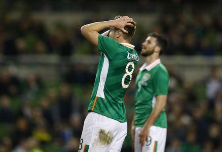 Republic of Ireland's Kevin Doyle looks dejected