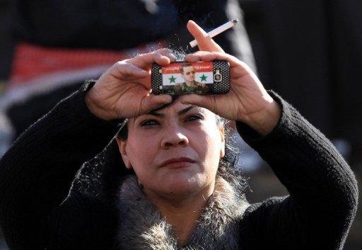 A Syrian government supporter takes pictures with her mobile phone bearing a sticker of Syrian President Bashar al-Assad during a pro-regime rally in Damascus in January 2012. For people living in countries where the the government monitors and censors the Internet, help is on the way
