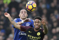 Everton's Ramiro Funes Mori, left and Manchester City's Raheem Sterling battle for the ball during the English Premier League soccer match between Everton and Manchester City at Goodison Park, in Liverpool, England, Sunday Jan. 15, 2017. (Peter Byrne/PA via AP)