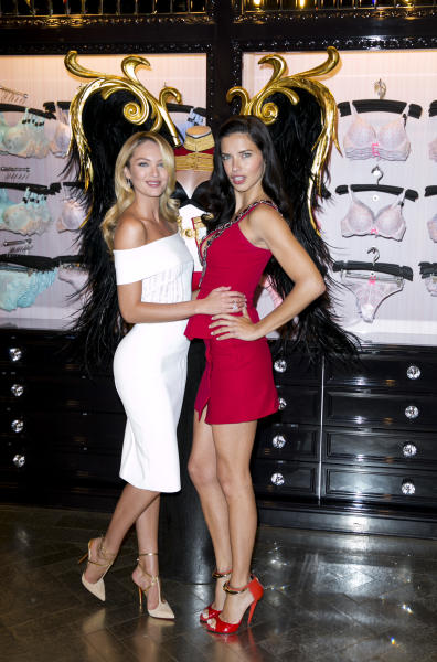 Victoria's Secret models Candice Swanepoel and Adriana Lima pose for photographers after a press conference at the Victoria's Secret New Bond Street store in central London, Tuesday, April 15, 2014, The Victoria's Secret models have announced that the Victoria's Secret Fashion show will be coming to London this year. (Photo by John Phillips/Invision/AP)