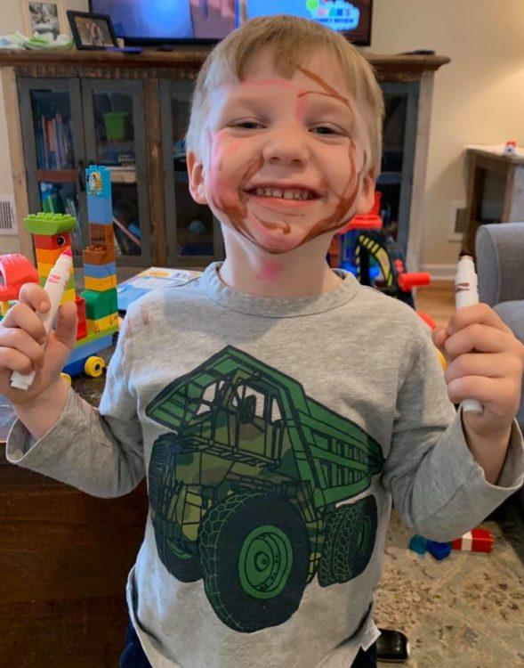 little boy with marker all over face