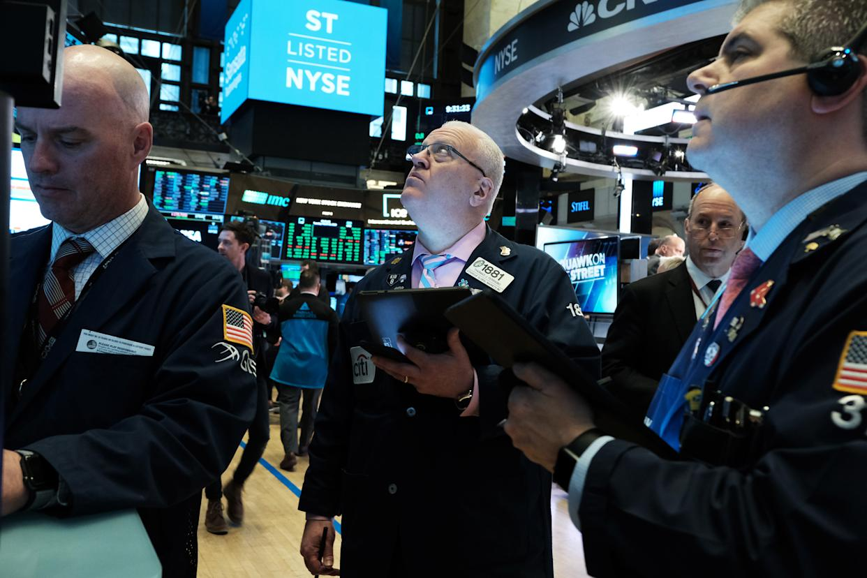 NEW YORK, NEW YORK - MARCH 10: Traders work on the floor of the New York Stock Exchange (NYSE)  on March 10, 2020 in New York City. After losing nearly 8 percent in a market rout yesterday, the Dow Jones Industrial Average was up over 700 points in morning trading as investors look to a possible tax cut and other measures by the Trump administration to combat the coronavirus. (Photo by Spencer Platt/Getty Images)