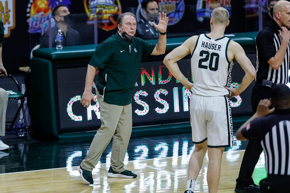 Michigan State head coach Tom Izzo talks to forward Joey Hauser during the second half against Nebraska at Breslin Center in East Lansing, Saturday, Feb. 6, 2021.