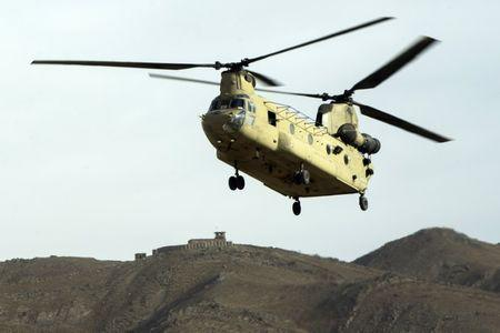 FILE PHOTO: A CH-47 Chinook helicopter from the 82nd Combat Aviation Brigade lands to pick up U.S. soldiers from the 3rd Cavalry Regiment after an advising mission at the Afghan National Army headquarters for the 203rd Corps in the Paktia province of Afghanistan December 21, 2014. REUTERS/Lucas Jackson