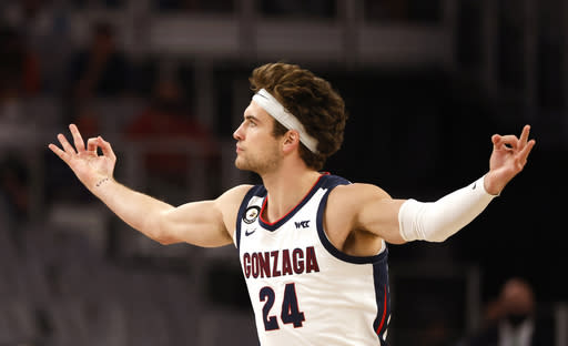 Gonzaga forward Corey Kispert (24) reacts after making a 3-point basket against Virginia during the first half of an NCAA college basketball game, Saturday, Dec. 26, 2020, in Fort Worth, Texas. (AP Photo/Ron Jenkins)