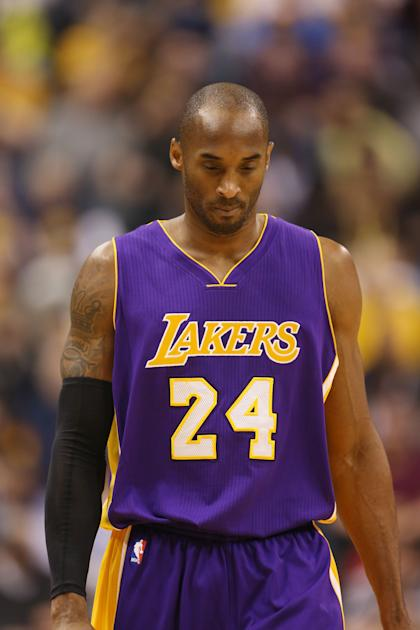 Dec 15, 2014; Indianapolis, IN, USA; Los Angeles Lakers guard Kobe Bryant (8) walks up the floor in a game against the Indiana Pacers at Bankers Life Fieldhouse. Indiana Pacers defeat the Los Angeles Lakers 110-91. (Brian Spurlock-USA TODAY Sports)