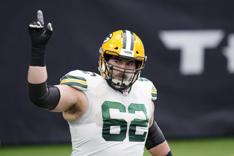 FILE - Green Bay Packers guard Lucas Patrick walks onto the field before the start of an NFL football game against the Houston Texans in Houston, in this Sunday, Oct. 25, 2020, file photo. Green Bay's offensive line lost two of its original five starters to season-ending knee injuries, with right guard Lane Taylor going down in the opener. They were missing All-Pro center Corey Linsley for three games at midseason. Now they're continuing their Super Bowl chase without Bakhtiari. Yet the line hasn't missed a beat while helping make the Packers the NFL's highest-scoring team. (AP Photo/Sam Craft, File)