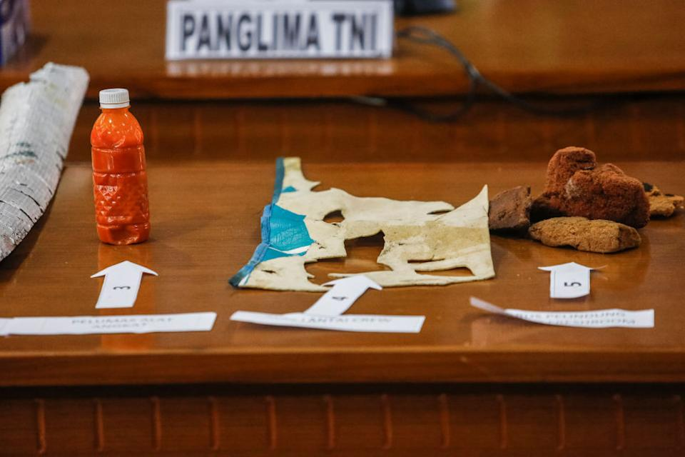Pictured are a grease oil bottle for periscope, crew floor mat and sponges believed to be from the missing Indonesian navy submarine.