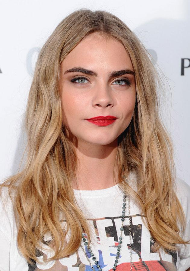 Cara Delevingne rocked red lips at the Glamour Awards. [Rex]