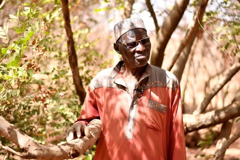 Sawadogo, a farmer, looks on in Ouahigouya